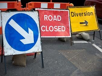 Road closure and diversion signs on a blocked road