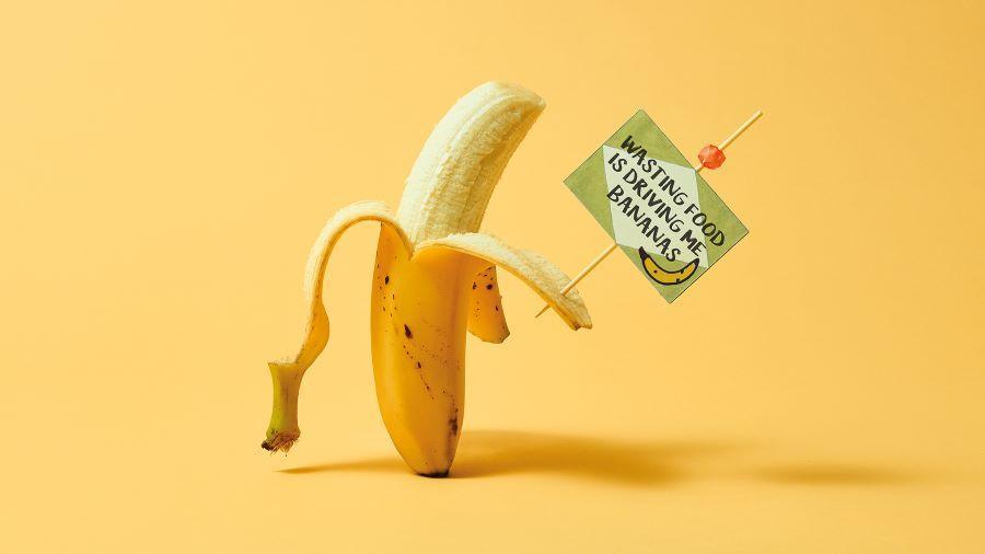 Banana holding sign 'wasting food is driving me bananas'